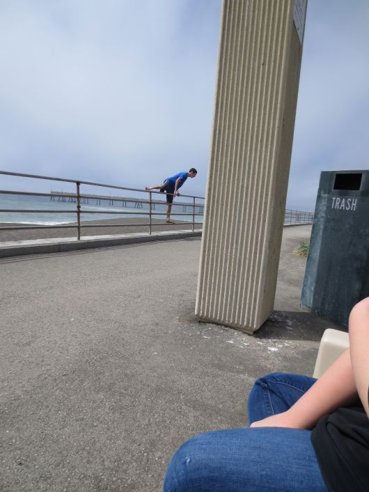 Teen jumping over railing